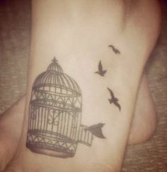 Pretty birdcage tattoo. If I were ever brave enough...