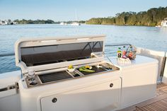 "Riviera 50 Enclosed Flybridge: The cockpit grill not only offers plenty of cooking space, but prep room and storage were not left ""on the back burner"" as it were. Note the port and starboard transom doors."