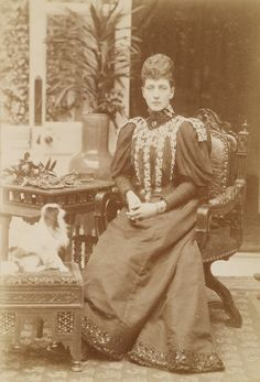 Portrait photograph of the Princess of Wales (1844-1925), later Queen Alexandra, with a small dog, 1890s | Royal Collection Trust