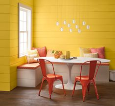 Rise and shine! Enjoy your morning smoothie in this luminous yellow kitchen nook. Popular shiplap walls and tangerine accents take this eating area up a notch. Paint Color: Valspar Daily Spell at Lowe's. Valspar Dear Melissa at Ace and Independent Retaile Yellow Paint Colors, Pastel Yellow, Yellow Painting, Yellow Walls, Shades Of Yellow, Mellow Yellow, Bright Colors, Red Color, Olympic Paint
