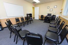 Meeting room - Recovery First is staffed by compassionate licensed, addiction physicians, psychiatrists, psychologists, social workers, nurses, counselors, behavioral health technicians, and support staff with years of experience working with addiction and recovery. | 888-979-7554