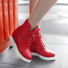 - Trendy studded wedge sneaker boots for the modern woman - Beautiful studs at heel for a unique look - Comfortable breathable upper - Made from PU - 7 cm wedge heel - Rubber sole - Available in 3 col