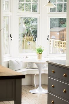 This lovely deVOL Shaker kitchen in Nottingham had the most beautiful ornate circular seating area where you could look out onto the garden.