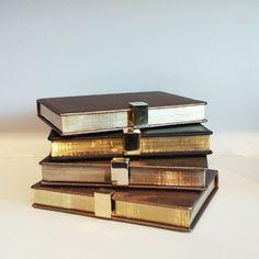 slufoot:  Smythson book clutches.