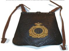 The sabretache was only worn in mounted order both in undress and full dress. It is black leather having a gilt badge with a silver bison head in the middle. Police Badges, Bison, Law Enforcement, North West, Messenger Bag, Satchel, Middle, Black Leather, Silver