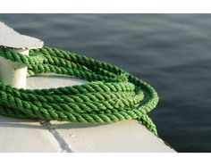 Quayside looped green rope.