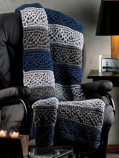 "Navy and grays combine quite handsomely in this afghan, perfect for any room in the home, cabin or cottage. Knit with 4 skeins each A, B and C of worsted-weight Red Heart Super Saver using U.S. size 17/12.75mm needles. Finished size 46"" x 60&quo..."
