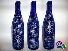 beautiful blue and silver painted wine bottles Recycled Glass Bottles, Glass Bottle Crafts, Painted Wine Bottles, Diy Bottle, Painted Wine Glasses, Wine Bottle Glasses, Wine Bottle Corks, Wine Craft, Creation Deco