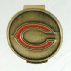 Chicago Bears Hat Clip & Golf Ball Marker by Waggle Pro Shop. $9.95. Clip fits hats, caps or belts and is always visible. Show your Bears pride with an NFL golf ball marker. Great gift idea for golfers. Never Lose Your Golf Ball Marker Again!. Magnetic golf ball marker sits securly on the hat clip. Show your team pride and spirit while you golf by wearing a Chicago Bears hat clip with a magnetic golf ball marker. Forget about fumbling through your pockets for a ball marker...