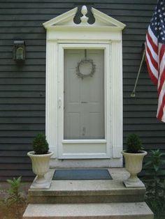 Dark gray house with gray door