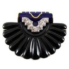 Cartier New York Art Deco Onyx Enamel Shell Clip. Cartier Art Deco platinum 18 karat yellow gold onyx enamel diamond shell clip, blue enamel, black onyx, signed Cartier, numbered 6150 1930
