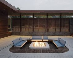 sunken seating area with fire pit and garden views