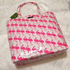 """NWT kate spade Flamingo Tote! NWT kate spade Daycation Bon Shopper Tote! ADORABLE flamingo print; perfect for summer! *NOTE the glossy finish; the white portion you're seeing on bottom is reflection of the light, not an imperfection.    SIZE: * 13.5""""h x 12.3""""w x 5.1""""d * drop length: 8.3"""" MATERIAL: * printed coated poplin * capital kate jacquard lining * style # wkru3238 DETAILS: * shoulder bag with an open top * dual interior slide pockets * silver printed kate spade new york logo kate spade…"""