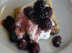 Brown Butter Blondies with Balsalmic Marinated Blackberries and Fresh Whipped Cream!  I would have to try with blueberries, but I bet this is heavenly!