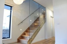 This staircase has an almost floating step effect with open rise steps and off-set stringer support. *Glass Balustrade Stairs*