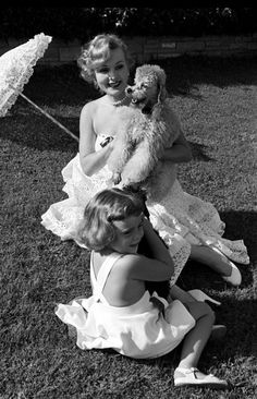 Zsa Zsa Gabor with daughter Francesca Hilton and their two poodles at their Bel Air, California home in 1951.