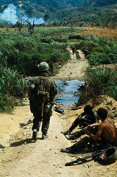 02 May 1968, A Shau Valley, South Vietnam --- A Communist built road serves as a footpath for members of the 1st Cavalry Division during Operation Delaware in the A Shau Valley. The road was built with metal strips, normally used by allied forces for constructing landing strips. It was disclosed April 28th that the cavalrymen had invaded the valley and fought a costly battle to establish a foothold in the Communist enclave.