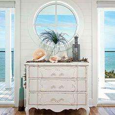 i like the circle window and dresser