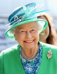 Love this hat! Queen Elizabeth II smiles as she visits the Glasgow National Hockey Centre to watch the 20th Commonwealth Games on July 24, 2014 in Glasgow, Scotland.