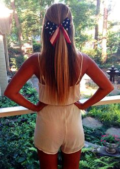 the white romper is adorable and the bow is a cute accessory for the 4th of July