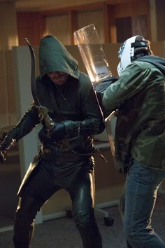 """Arrow -- """"Legacies"""" -- Image AR106a_3400b -- Pictured (L-R): Stephen Amell as Arrow and Kyle Schmid as Ace -- Photo: Jack Rowand/The CW -- ©2012 The CW Network. All Rights Reserved"""