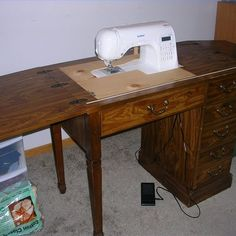 I totally need to do this. Sewing Cabinet Converted for New Sewing Machine