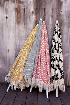 June Must Haves: Textile nerds will be hitting the beach this Summer with Kerry Cassill's collection of breathtaking beach umbrellas ($210). Fringed and patterned, these showstoppers come in seven stock options but can also be customized with any Cassill upholstery-weight fabric.     — Angela Elias, assistant editor