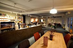 Concrete Bar design , hardwood tables , coffee shop design