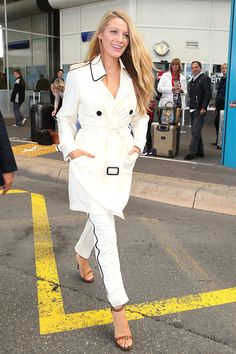 9 May Blake Lively arrived at Nice airport ahead of the festival wearing a white Burberry trench-coat with matching tailored trousers.   - HarpersBAZAAR.co.uk