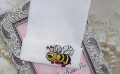 A personal favorite from my Etsy shop https://www.etsy.com/listing/288400465/newborn-hospital-hat-bumble-bee-applique