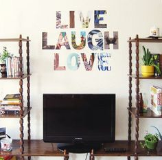 "Make your home warm and welcoming with a ""Live, Laugh, Love"" display made from magazine pages in your living room.Photo: Pinterest/Anna Uecker"
