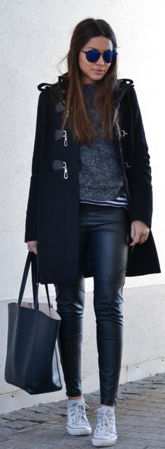 Street Style February, 2015: Consuelo Paloma is wearing a coat and sweater Mango, striped shirt from Zara, leather trousers and bag from H&M and the sneakers are from Converse