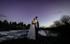 Matt Shumate Photography Chateau Rive wedding bride and groom romantic portrait in spokane with river and sunset in background