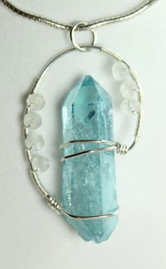 Handmade Healing Crystal Pendant: Reiki Infused Aqua Aura Quartz Point and Rainbow Moonstone Sterling Silver Wire Wrapped Pendant. $38.00, via Etsy.