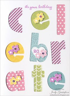 A Celebration card with filled in letters of cheerful Paper Fundamental colors and accented with coordinating flowers.