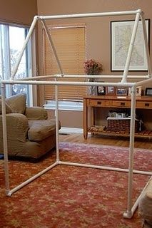 """PVC playhouse, just add sheets!   (I like to use drapery sheers. - the kids feel """"hidden"""" and I can see them. -n)"""