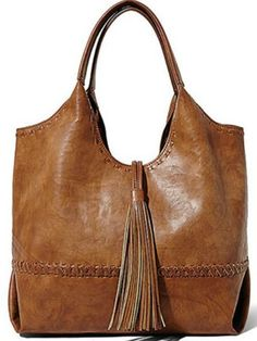 Braided treatment on the edges and seams gives this chic hobo added visual appeal while a large tassel detail finishes it off with a touch of boho-chic charm. Tote Purse, Tote Handbags, Purses And Handbags, Boho Chic, Accessories, Totes, Hobo Bags, Large Tote, Leather Bags