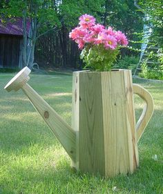 Get the plans for this watering can planter from ChesapeakeCrafts.com