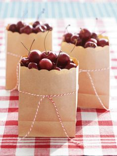 Blah brown sacks can bear fruit, beautifully. All you need to transform paper lunch bags into chic little cherry carriers is a pair of scallop-edged scissors — though a bit of baker's twine never hurts!