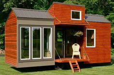 "A stunning tiny house with a modern exterior. The home is perfect for taller tiny house dwellers with 6'8"" ceilings."