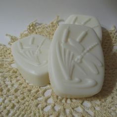 Coconut Lemongrass is fruity, beachy, with just a little bit of zip that keeps it from being overly sweet. | Coconut Lemongrass scented soap in a Cattail and Dragonfly design