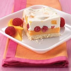 Mango Raspberry Frozen Dessert - This light dessert recipe features sorbet, fresh raspberries and a mango mousse layered on top of a shortbread crust.