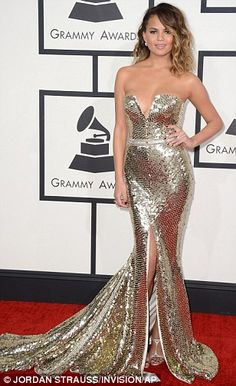 Shiny and slinky: Chrissy arrived at the red carpet in a gorgeous sleeveless, metallic dre...