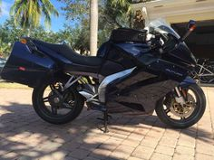 Used 2001 Aprilia RST FUTURA Motorcycles For Sale in Florida,FL. Here for sale is My 2001 Aprilia Futura RST1000, it's truly a charm to ride but I am moving overseas. This is a fully equipped sport-touring style motorcycle that includes nicely-sized hard cases and a large tank bag. This motorcycle was ahead of its time, hence the name, and has plenty of capability for its cost. The reliable V-Twin is known to be bulletproof and has more than enough get up and go. Brand new Michelin Pilot 2's…