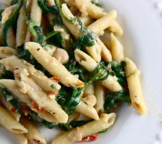 Pasta with red peppers,greens,white beans,garlic and lemon zest.