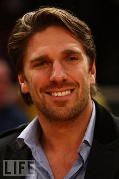 """Henrik Lundqvist. So not only does he look like that but he's 6'1"""", plays hockey & the guitar, owns businesses, likes fashion, has charisma... that wife of his is one lucky lady. One in a million find."""