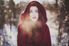 I don't like the red on red here. I do like her cape and the winter breath and her looking Fairy talish