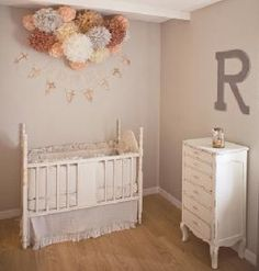love the little collection of flower balls above the crib