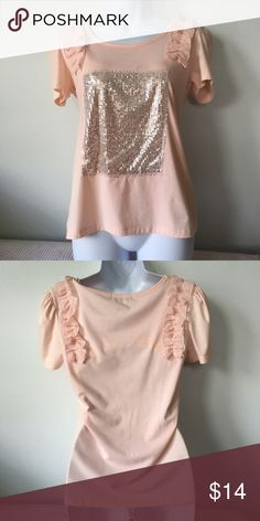Cute t-shirt  NWOT. Adorable peach t-shirt with sequin design and frill details on shoulders. The frilly shoulders would make this super cute to pair with overalls or suspenders! Brand new! Never been worn.  I bundles so check out my other listings too! If you see something you like, throw in an offer! Thanks for stopping by :D Tops Tees - Short Sleeve