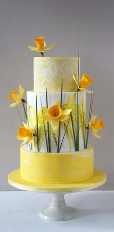 Made for a 70th Birthday. Daffodils are made without cutters, handpainted watercolour mid tier with edible lace for the top and marble effect for the bottom.Hope you all like!